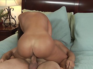 Brunette Lisa Ann with massive jugs enjoys some dick sucking in oral action with Anthony Rosano