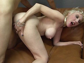 Blonde with gigantic breasts enjoys the warmth of dude's stiff pole deep in her vagina
