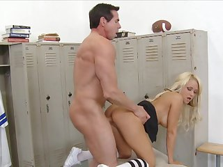 Blonde Brandy Blair with huge breasts gets her mouth destroyed by Peter North's ram rod