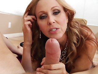 Blonde Julia Ann with giant tits swirls the tongue around Mark Woods cock while sucking