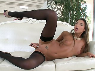 Sexy Maria Rya dildos her twat in black stockings