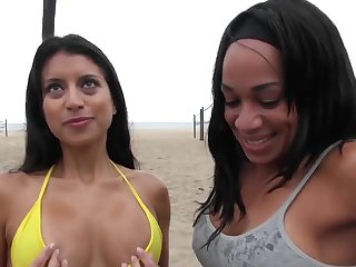 Bikini girls get picked up on the beach