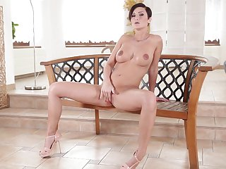 Redhead Bella Baby has fire in her eyes as she masturbates