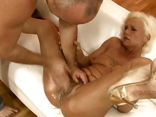 Mature fucking herself with dildo
